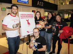 """Our teammates pose for the Pupparazzi before boarding our """"Operation Chihuahua"""" flight."""