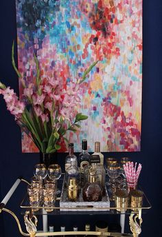 This is GORGEOUS. Good way to tie in color while keeping the furniture muted and neutral. {Swoonworthy bar cart and art}