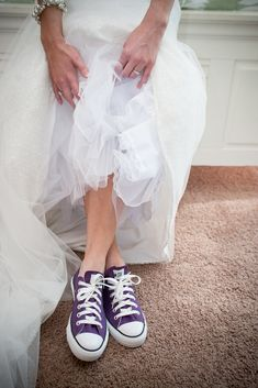 A bride after my own heart with purple converse shoes. except I would want blue so I would have something blue <3