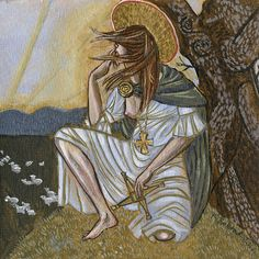 "The painting of the Goddess Brigid or St. Brigid inside the icon box. Included are symbols of Brigid: Brigid's cross, the oak tree, dawn light, sheep, her green cloak, and the metalwork brooch and cross around her neck. She is also sitting on a hill, for she is the Goddes of ""high places"". Copyright Karin Bolstad 2012"