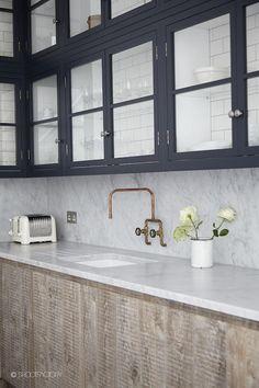 instead of dark-framed windows maybe dark-framed upper cabinets?
