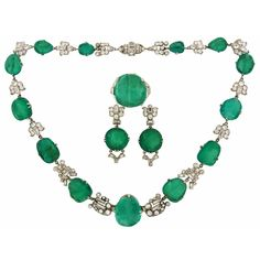 1930s MAUBOUSSIN Emerald Diamond Platinum Necklace Ring Earrings Set, Stunning Art Deco set consisting of a necklace, a ring and a pair of earrings created by Mauboussin in France in the 1930's. Features sixteen carved emeralds set in platinum and accented with Old European cut and baguette cut diamonds.