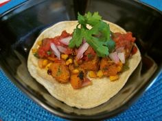 Seasoned Butternut Squash Tacos http://www.shrutisdilectabledilites.com/2013/09/12/seasoned-butternut-squash-tacos-with-roasted-corn-and-capsicum/