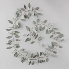 Pressed metal eucalyptus leaves adorn this delicate strand for sprucing up natural décor, found only at terrain. - A terrain exclusive- Iron, beads- Indoor use only- Twig Wreath, Hydrangea Wreath, Aqua Christmas, Christmas Garlands, Christmas Tree, Eucalyptus Garland, Eucalyptus Leaves, Floral Fascinators, Pressed Metal
