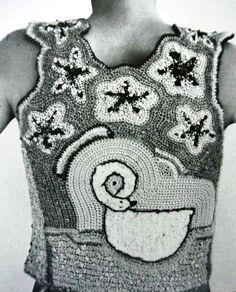 http://www.crochetconcupiscence.com/2012/07/edgy-1970s-crochet-art-dina-schwartz-knapp/