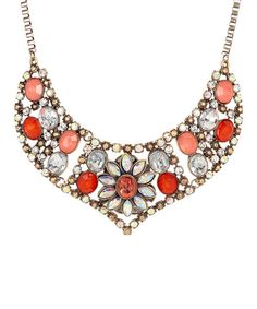 Boasting nothing less than chic sophistication, this piece is a sure way to get noticed. Dazzle every eye by decorating the neckline with a bib necklace crafted with a polished, candy-coated color and lustrous hints of shimmer.Chain: 18'' long with 2'' extenderBib: 2'' long14k gold-plated metal / resin / crystal