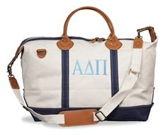 Whether traveling with your sorority sisters or visiting home for the weekend, travel in style with our handsome canvas and leather weekender bag.  Bag is made of 20 ounce sturdy cotton canvas with leather accents and handle; has zipper top closure with one inside zipper pocket and two inner standard pockets.