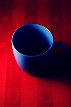 photo of a blue coffee mug on a red table Blue Shades Colors, Shades Of Red, Aesthetic Coffee, Blue Aesthetic, Blue Coffee Mugs, Colour Board, Red White Blue, Cobalt Blue, Yellow