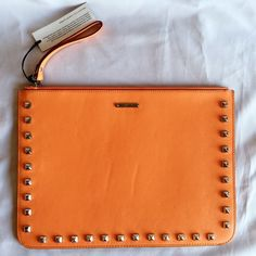 """Rebecca Minkoff Studded Oversized Clutch Gorgeous fall color! Silver studs on both sides. Has some minir creasing on the back leather. Brand new with tag! Can also fit an Ipad and other necessities! Dimension: 12""""x9"""" Rebecca Minkoff Bags Clutches & Wristlets"""