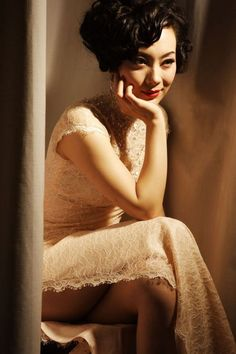 Love the white lace cheongsam, but I wouldn't dare wearing that high of a slit :)