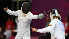 Lena Schoneborn of Germany competes against Laura Asadauskaite GOLD of Lithuania. Lena Schoneborn (L) of Germany competes against Laura Asadauskaite of Lithuania during the fencing in the women's Modern Pentathlon on Day 16 of the London 2012 Olympic Games.  (sun aug 12, 2012)
