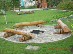 Flagstone Log Fire Pit plus other  great firepit ideas