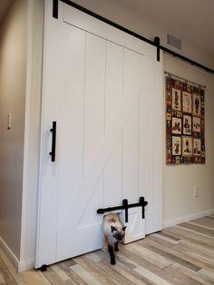 Custom cat barn door built on a barn door for a laundry room. Laundry Room Doors, Small Laundry Rooms, Laundry Room Design, Room Door Design, Basement Doors, Basement Laundry, Basement Ceilings, Barn Door Designs, Bar Designs