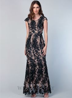 Violet Maxi. A beautiful full length dress by Romance the Label. A high neckline style featuring textured embroidery with chiffon flower applique and cap sleeves.