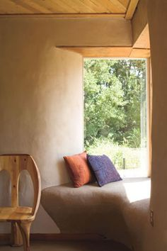 love straw bale houses and every window could have a window seat!