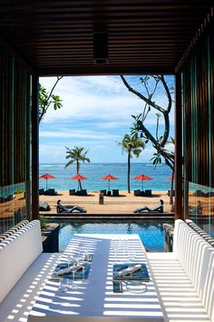 St.Regis Resort, Bali. Incredible view. Curling up with a good book on one of those beach chairs...me in a heartbeat.