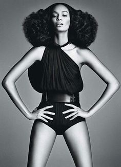 Joan Smalls.   I used to achieve this look by doing a braid-out of two giant pigtails.