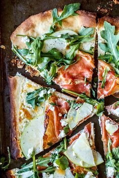 Prosciutto, Apple, and Goat Cheese Pizza//super thin crust pizza layered with goat cheese sauce, prosciutto, granny smith apples, apricot drizzle, and arugula//Crestview Kitchen