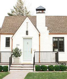 Exterior brick paint color is Benjamin Moore China White. Grey Door paint color is Benjamin Moore Greyhound.)