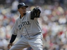 Felix Hernandez #34 of the Seattle Mariners delivers a pitch against the Minnesota Twins during the first inning of the game on May 18, 2014...