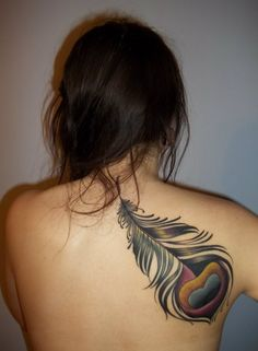 I really like these big colorful feather tattoos.