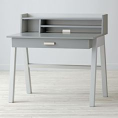 "With a unique two-tone construction, our Division Desk is a piece of kids' furniture unlike any other. Featuring a zinc drawer pull with brushed silver accents, it's stylish enough to go anywhere in your house. And the smooth rolling metal drawer glides give little ones easy access. Add the removable hutch (sold separately) and create even more space for books, folders and more.<br /><br />Shop our collection of exclusive <a href=""/kids-desk-chairs/kids-furniture/1"" title=desk chairs"">desk…"