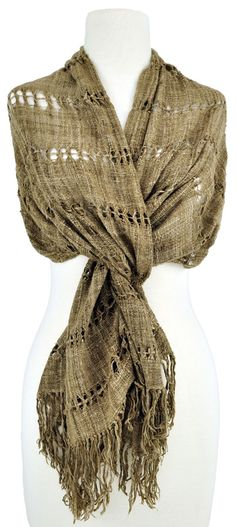 from Cloth Roads: This light-brown handspun, handwoven silk scarf from Madagascarcreates a soft wrap with an excellent drape.Horizontal bands of weft-leno lace alternating with plain weave create a lacy feel. Each lace band is about 1/2″ wide; the plain weave bands are about 2 1/2″wide.The wrap is finished with simple tied fringe.