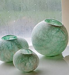 Shells series by Rahola Drdul Merino wool, silk This series of shells is made of felt so fine that light shines through them revealing the hand dyed silk within.