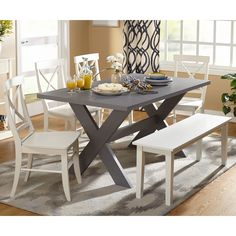 The Sumner Dining Set has a relaxed and transitional style that is reminiscent of backyard barbeques. With (4) four chairs, a generous bench, and an X-base designed table, you have everything you need for large gatherings.