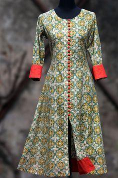 an elegant anarkali in lemon yellow hand-block printed bagru and fabric buttons…