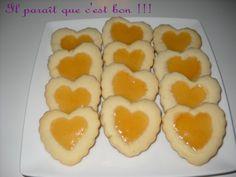 Petit beurre à la confiture  25 janvier 2010 by Nadia 1 Comment  DSCN0357 Trop gras me direz vous lorsque vous aurez vu la quantité en beurre mais tout sera oublié lorsque vous aurez mis ce joli petit biscuit en bouche et que vous vous rendrez compte de son fondant. Un pur délice !!!  Une recette trouvée sur le blog de ma cabane aux délices, un blog que je j'affectionne particulièrement.  DSCN0391  Ingrédients :      Pour la pâte :  500 g de beurre 200g de sucre glace 2 oeuf...