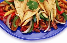 In this vegetarian and vegan meat-free tempeh fajitas recipe, tempeh is simmered in a juicy mixture of pineapple juice, lime juice and savory spices before being grilled and wrapped in a flour tortilla with chipotle salsa.
