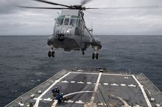 USS Ford conducts air operations. Sailors aboard the Oliver Hazard Perry-class guided-missile frigate USS Ford (FFG 54) retrieve a package from a Canadian Sirkorsky CH-124 Sea King helicopter