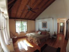 Master suite with king-sized bed and breathtaking views of the turquoise waters of Fiji. Bure. Kulu Bay Resort.