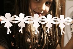 make paper chain fairies with this tute    http://scrapsofstarlight.blogspot.co.uk/2012/08/make-whimsical-fairy-paper-chains.html#