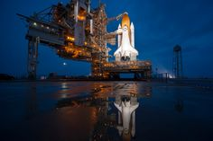 The space shuttle Atlantis stands shortly after the rotating service structure was rolled back at launch pad 39A at the NASA Kennedy Space Center in Cape Canaveral, Florida July 7, 2011. (Bill Ingalls-NASA/Reuters/Handout)