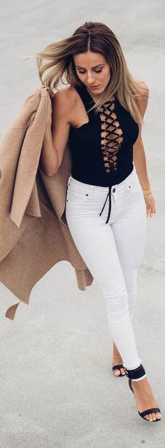 This edgy black lace top looks hot with skinny white jeans. Via Sendi Skopljak.