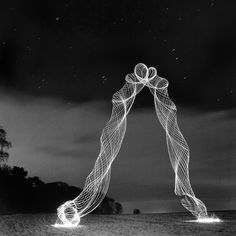 the light painting photography of Martin Kimbell, he puts a new spin on light painting with his creative light 'tornadoes