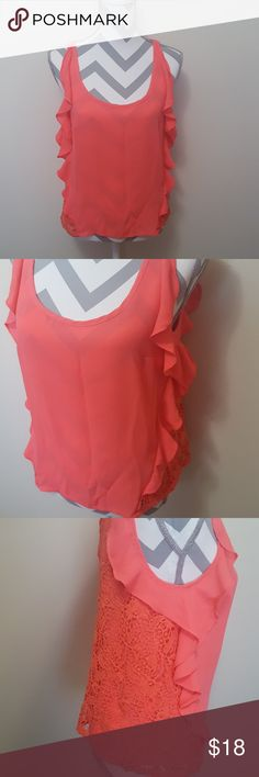 LC Lauren Conrad Lace Overlay Crochet Ruffle Top LC Lauren Conrad brand in a size Small. This is a pretty coral/pink color. The top is sleeveless and bra friendly. It has front chiffon ruffles and the sides and back has a crochet overlay. It is lined and not see through at all. Smoke free home and fast shipping. I do offer bundles deals as well. Thank you for checking out my closet. LC Lauren Conrad Tops