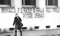 """""""Democrazia è il fucile in spalla agli operai, Potere Operaio"""" (Democracy is the rifle on the workers' shoulder, Potere Operaio). Written wall in front of the factory Alfa Romeo, Milan,"""