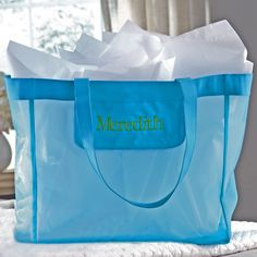 Our turquoise mesh bridesmaid wedding day tote holds everything she needs for the big day. Free personalization of her first name in one of 20 color choices.