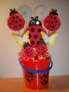 Bucket filled with curled ribbon and lollipops. Put some of each crafts on a stick and in the bucket