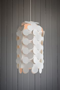 The PLATO THOMAS 20 lampshade is a playful vertical expression of the PLATO design from New Zealand designer Kris Ericksen (and house guest Thomas!).   This light playfully warms any space it occupies, creating the perfect blend of modernism and romance.