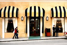 This commercial awning is certainly an exceptional design construct. Fabric Awning, Awning Canopy, Facade Design, Exterior Design, Mellow Yellow, Black N Yellow, Shop Awning, Yellow Shop, Shop Buildings
