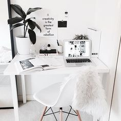All white workspace with a perfect minimalist white desk...so simple + stylish+ the inspo print is chic.