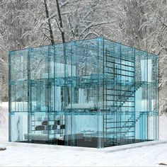 This Glass House resides in the Forests of Italy and was designed by Carlo Santambrogio and Ennio Arosio