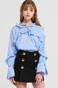 Cynthia Ruffle Blouse Discover the latest fashion trends online at storets.com #fashion #ruffle #blouse #storetsonme