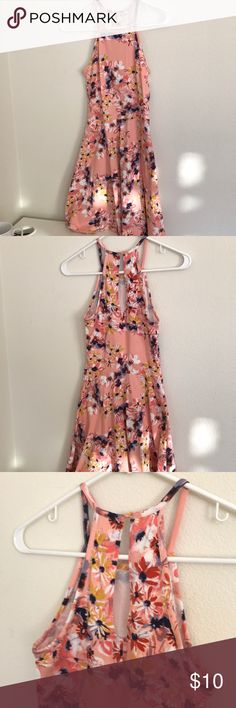 Sleeveless Skater Dress Sleeveless skater dress with button in back and eyelet peephole detail in back. Clean, no damage. Mossimo Supply Co Dresses Mini