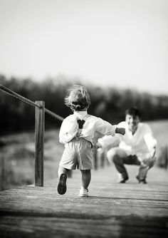 We love this photo of a little boy running to his Dad's open arms. #love #sons #fathers
