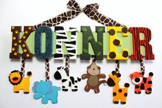 Jungle animal print baby name sign hand painted hanging zoo animal wall letters.